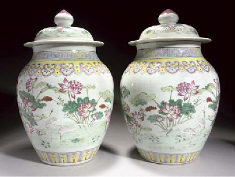 A pair of famille rose jars an