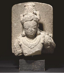 A VOLCANIC STONE FIGURE OF A B