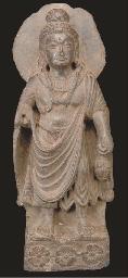A Gandharan grey schist figure