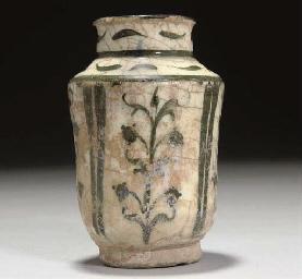 A small Kashan pottery albarel