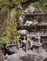 A PAIR OF LEAD URNS