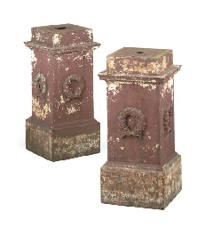 A PAIR OF CAST IRON PLINTHS