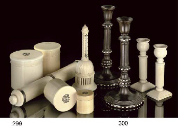 A PAIR OF LATE VICTORIAN EBONY AND IVORY INLAID CANDLESTICKS...