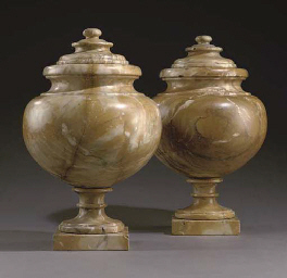A PAIR OF MARBLE URNS AND COVE