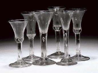 SIX VARIOUS PLAIN-STEMMED WINE