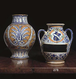A TUSCAN MAIOLICA ARMORIAL TWO-HANDLED OVIFORM JAR