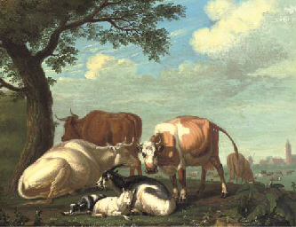 Cows and goats resting by a tr