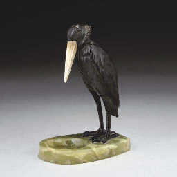 AN ONYX ASHTRAY MOUNTED WITH A