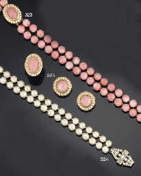 A suite of coral and diamond jewellery