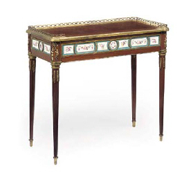 A LOUIS XVI ORMOLU AND PORCELAIN-MOUNTED MAHOGANY TABLE A EC...