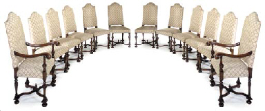 A SET OF TWELVE WALNUT DINING CHAIRS