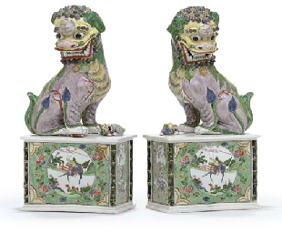 A LARGE PAIR OF BISCUIT-GLAZED BUDDHIST LIONS
