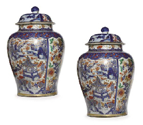 A VERY LARGE PAIR OF VERTE-IMARI JARS AND COVERS