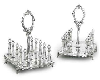 A PAIR OF SILVER-PLATED TOAST-