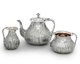 A VICTORIAN SILVER THREE-PIECE TEA-SERVICE