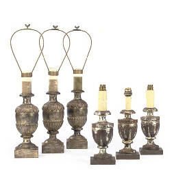 A SET OF THREE SILVERED WOOD T