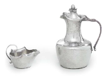 A DANISH SILVER HOT-WATER JUG