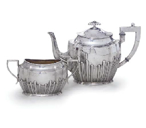 A GERMAN SILVER TEAPOT AND SUG