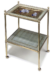 A LACQUERED-BRASS AND GESSO TW