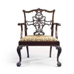 A LATE VICTORIAN MAHOGANY ARMCHAIR