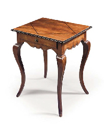 A FRENCH PROVINCIAL WALNUT AND EBONISED WRITING-TABLE