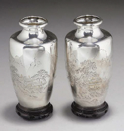 A pair of Japanese silver vases, signed, Meiji/Taisho period...