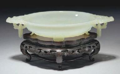 A Chinese pale celadon jade bo