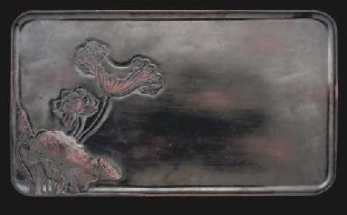 A Chinese black lacquered wood