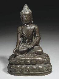 A Tibetan bronze model of Budd
