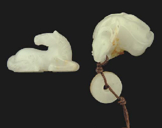 A small Chinese white jade carving of a recumbent deer