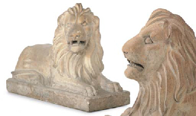 A PAIR OF SCOTTISH STONEWARE MODELS OF RECUMBENT LIONS