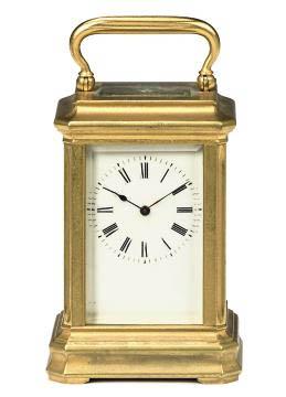 A rare French miniature gilt-brass striking eight day carria...