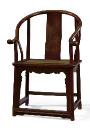 A CHINESE HUANGHUALI HORSESHOE BACK ARMCHAIR