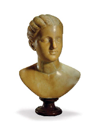 A WHITE MARBLE BUST OF A GIRL