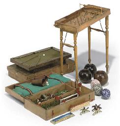 AN EDWARDIAN MINIATURE BRASS MOUNTED OAK BILLIARDS TABLE