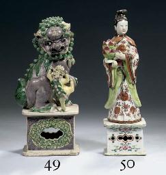 A famille verte figure of a bu