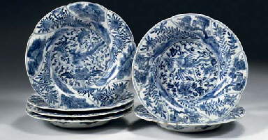 A set of six blue and white pl