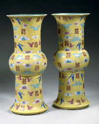 A pair of yellow ground vases,