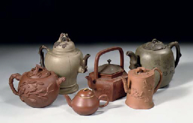 An assorted lot of six Yixing teapots and covers