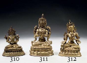 A Tibetan gilt-bronze figure o
