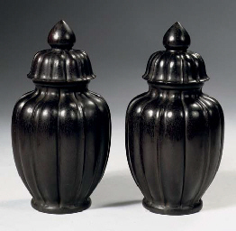 A pair of Zitan vases and cove