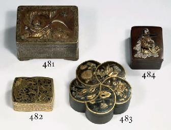 A bronze cinquefoil box and co