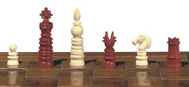 AN ENGLISH IVORY CHESS SET AND