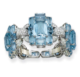 A RARE AND SUPERB ART DECO AQUAMARINE AND DIAMOND BANGLE, BY CARTIER