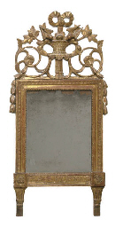 A LOUIS XVI CARVED GILTWOOD WALL MIRROR