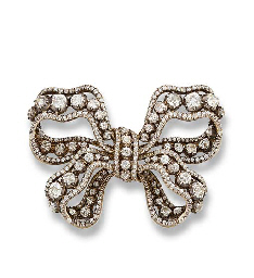 AN ANTIQUE DIAMOND BOW BROOCH, BY MUSY