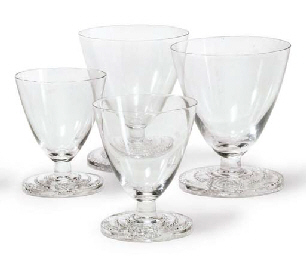 A pair of Bordeaux wine glasses and a pair of white wine gla...