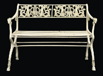 A GERMAN WHITE-PAINTED CAST-IR