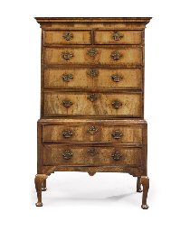 A GEORGE I WALNUT CHEST-ON-STA