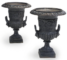 A PAIR OF CAST IRON GARDEN URN